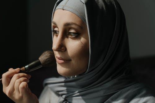 Woman in Black Hijab Holding Makeup Brush