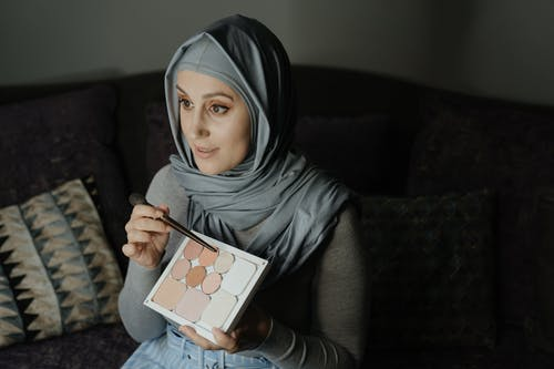 Woman in Gray Hijab Holding White Ipad