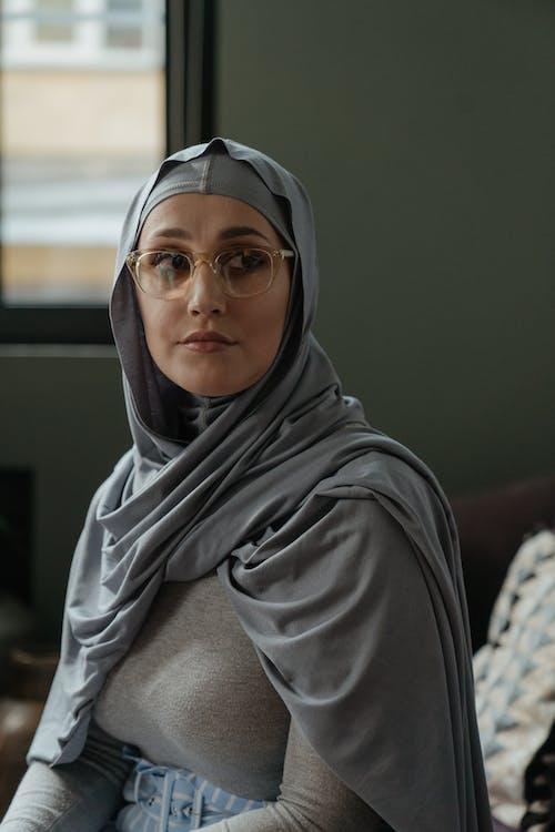 Woman in Gray Hijab and Gray Long Sleeve Shirt