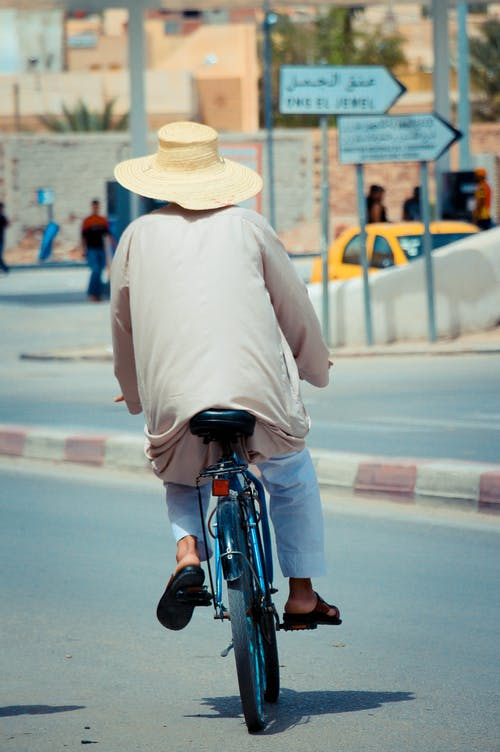 Photo Of Person Riding A Bike