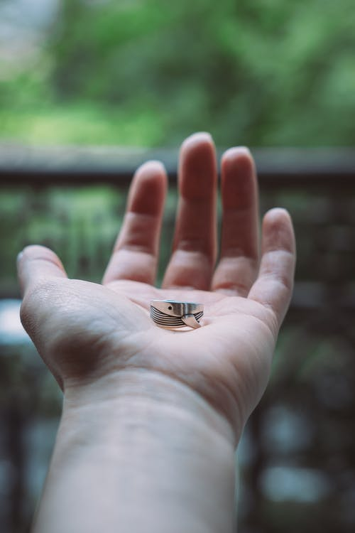 Photo Of Person Holding Silver Ring