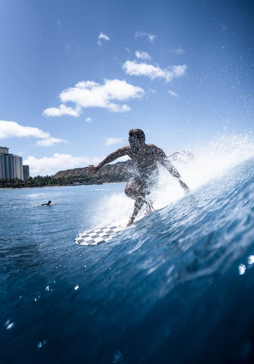 Photo Of Man Surfing