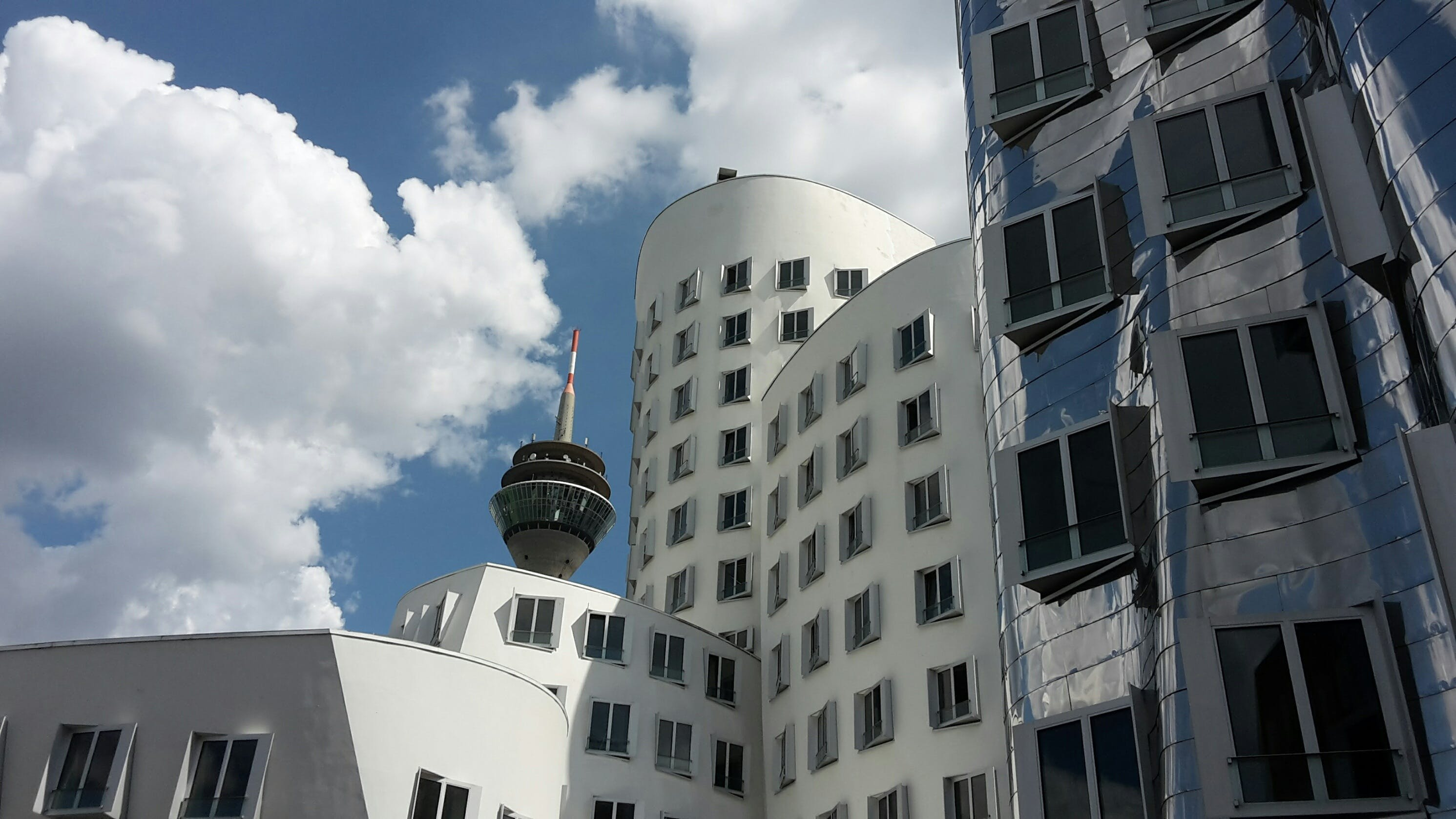 White Concrete Building Under Cloudy Sky