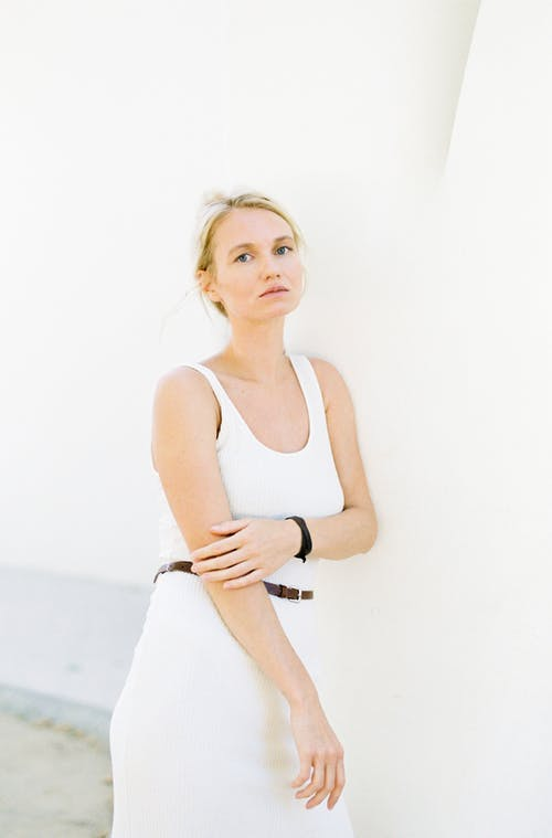 Photo Of Woman Wearing White Tank Top
