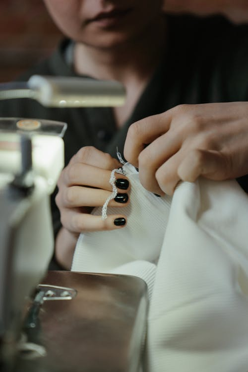 Person Holding Silver and Black Ring