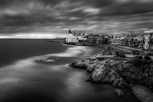 Small coastal town under cloudy sky