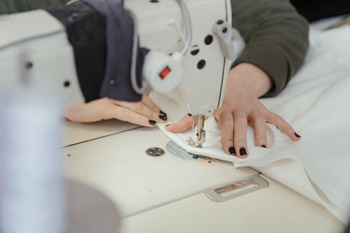 Person in White Shirt Sewing
