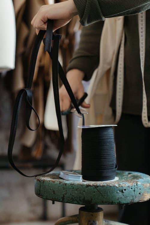 Black Leather Sling Bag on Blue and White Ceramic Mug