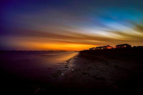 Gratis arkivbilde med bakbelysning, daggry, england, hav