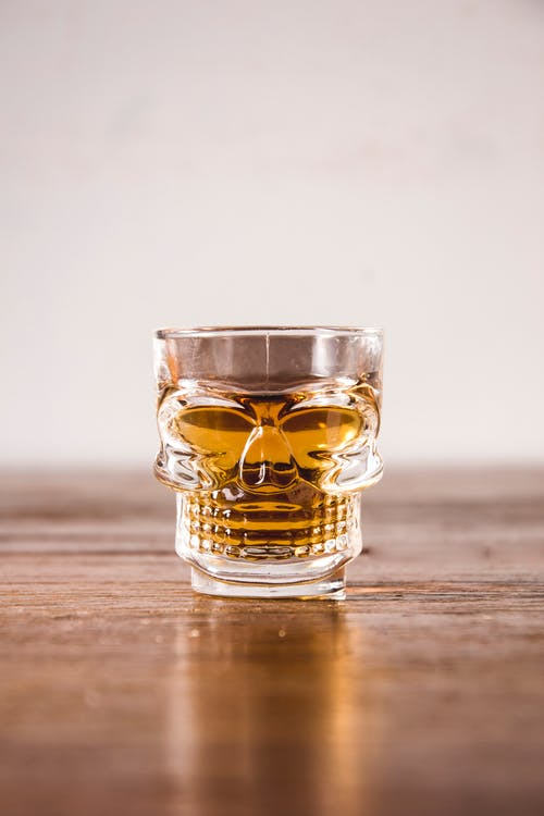 Clear Shot Glass With Yellow Liquid