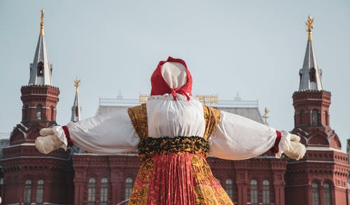 Person Standing in front of Kremlin