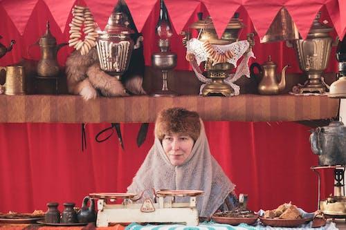 Woman Selling Samovars at Market