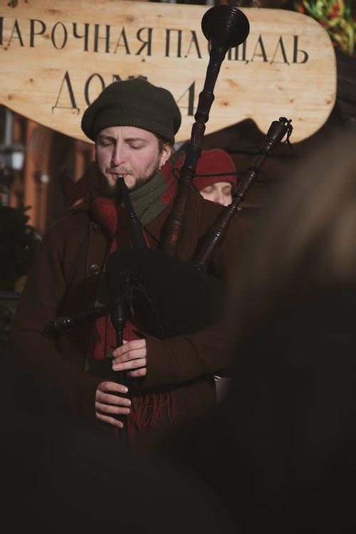Man Playing Bagpipe