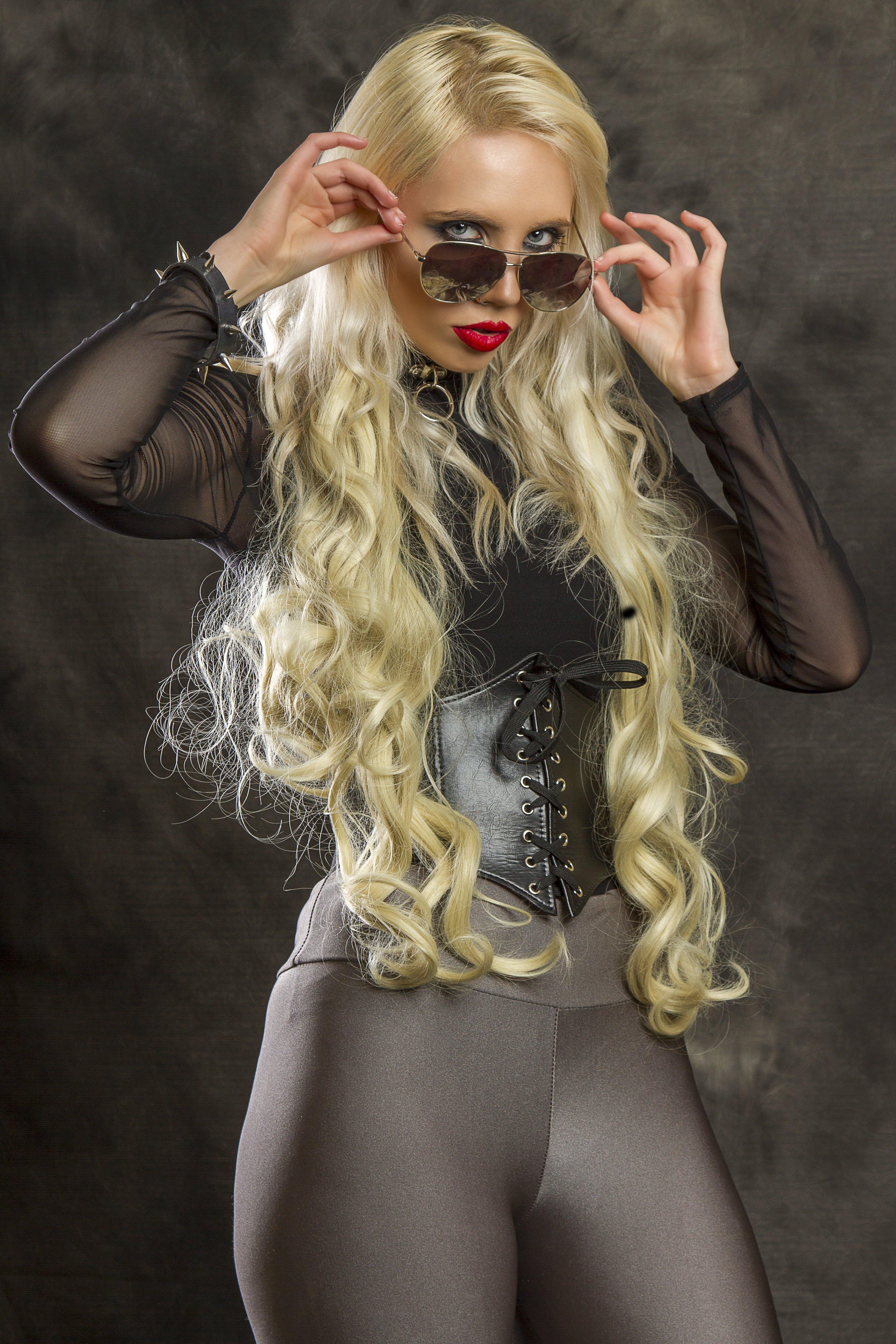 Woman Wearing Black Framed Aviator-style Sunglasses