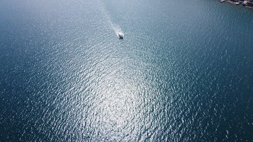 rippling sea water with boat on sunny day