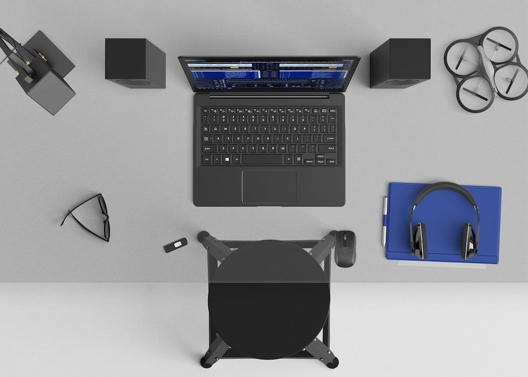 Flat Lay Photography of Laptop Computer, Headphones, and Speaker