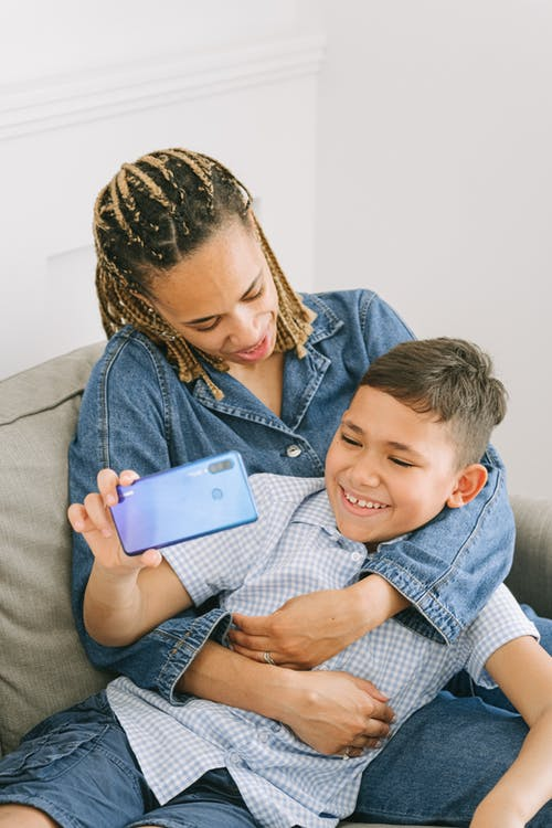 Young Boy with Woman Taking a Selfie