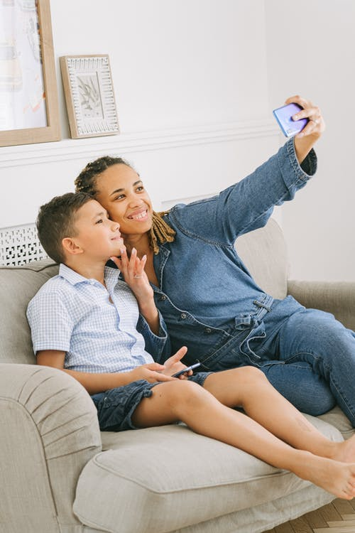 Woman with Young Boy Taking Picture