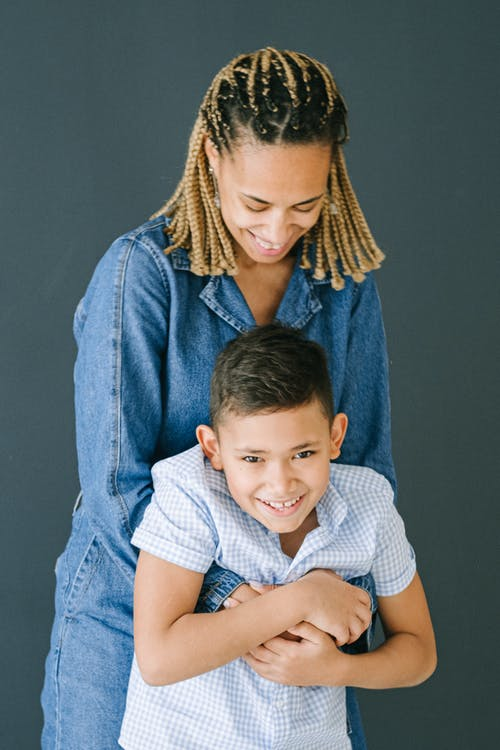 Woman Hugging Son From Behind
