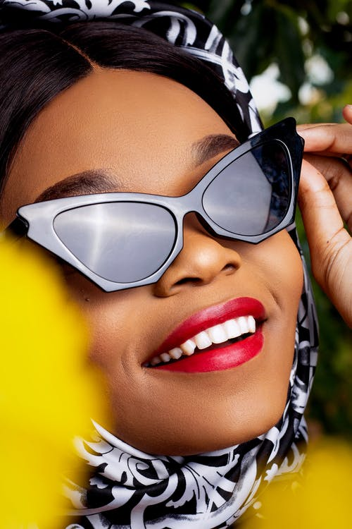 Crop stylish black woman face in trendy sunglasses