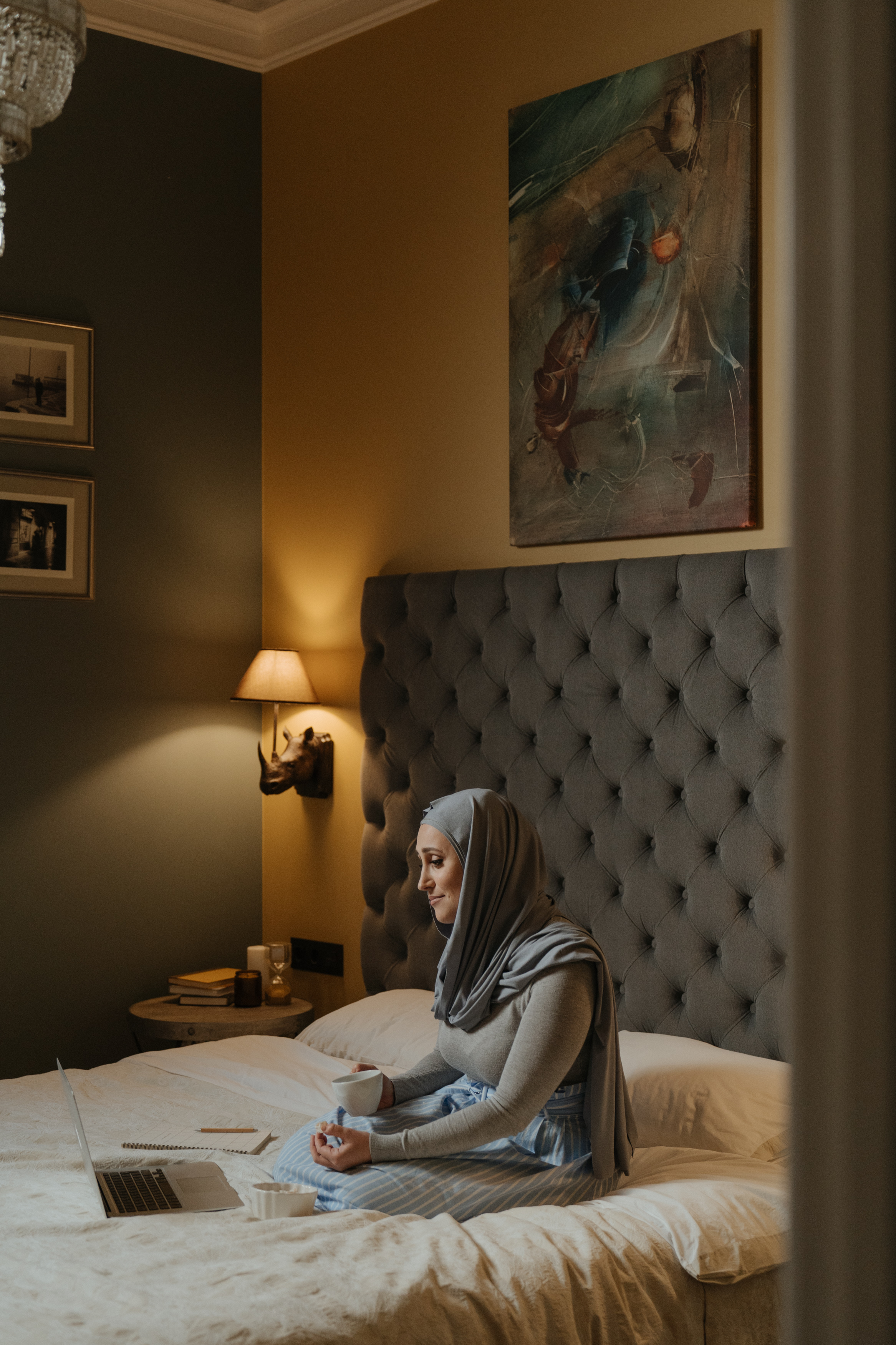 woman in gray hijab using laptop