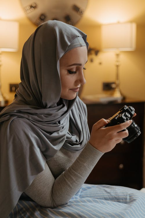 Woman in Gray Hijab Holding A Camera