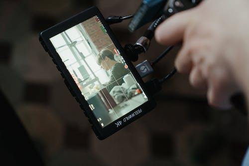 Black Android Smartphone Displaying Man in Black Blazer