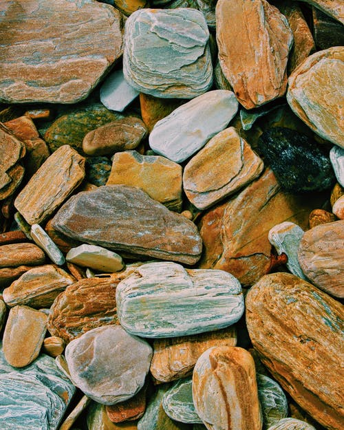 Textured background of colorful dry stones in daylight