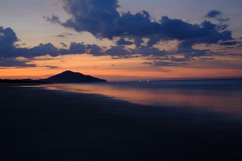 Foto stok gratis cahaya matahari, cuaca cerah, lautan, malam biru