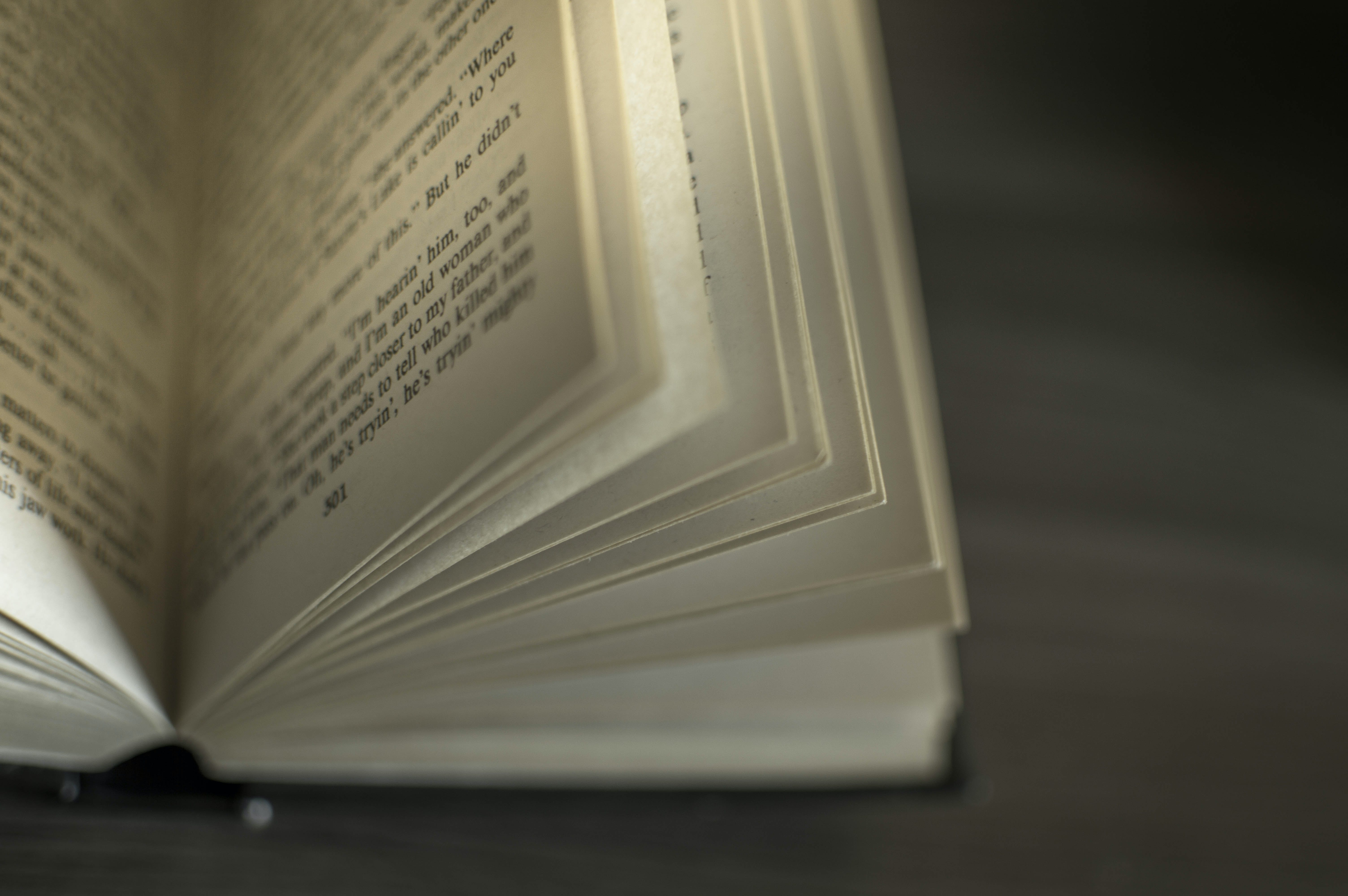 Opened Book on Black Surface