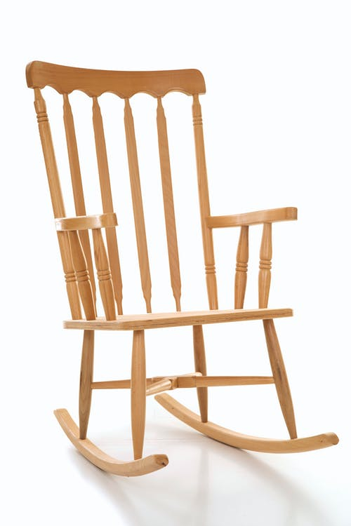 Brown Wooden Rocking Chair With White Background