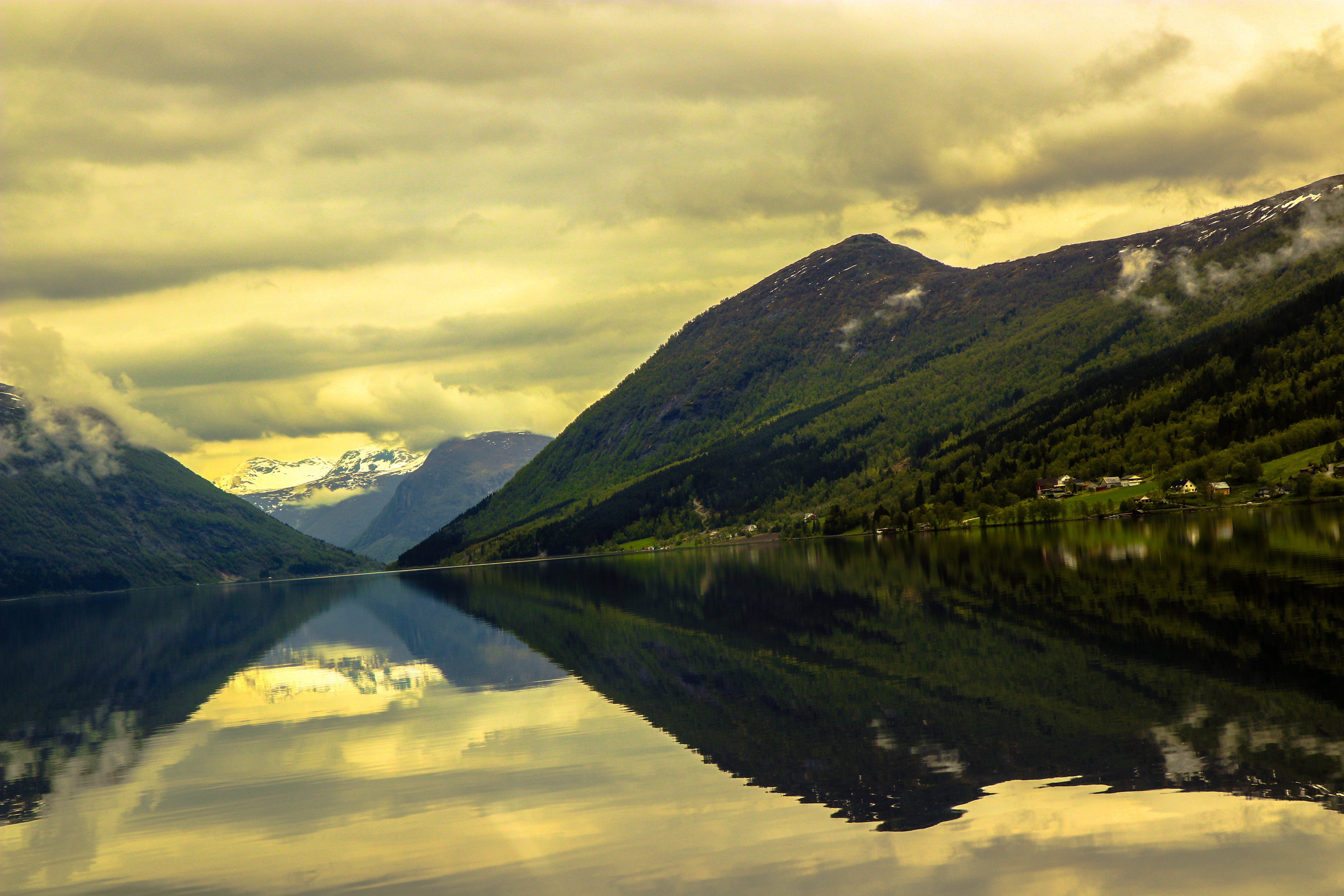 Reflective Photography of Mountain and Body of Water