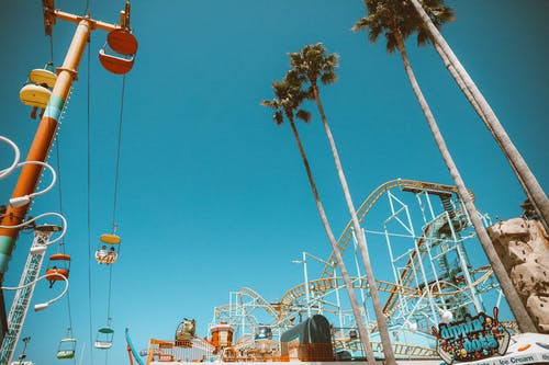 White and Orange Cable Car Under Blue Sky