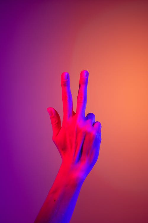Persons Hand With Purple Manicure