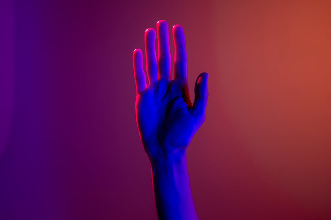 Persons Left Hand With Purple Manicure