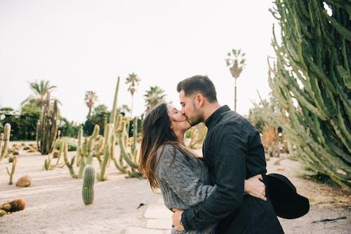 Photo Of Man Kissing Woman