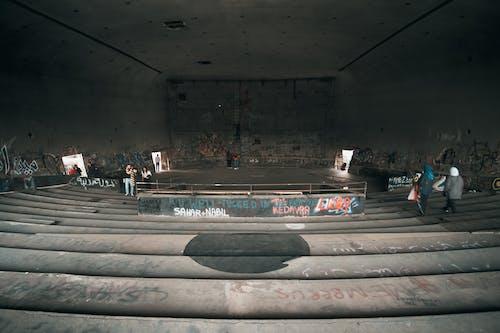 People Inside Desolate Building