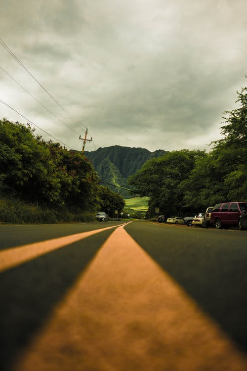 Photo Of Road Under Cloudy Sky