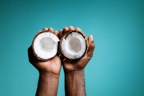 Photo Of Person Holding Coconut
