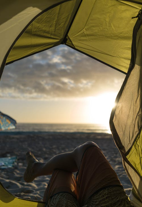 Photo Of Person Laying On Tent