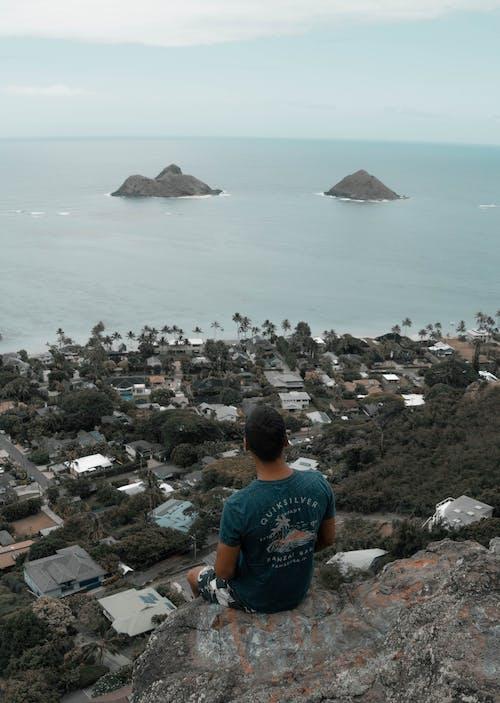 Photo Of Man Sitting On Edge Of Cliff