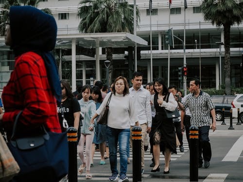 Group of People Crossing The Pedestrian Lane
