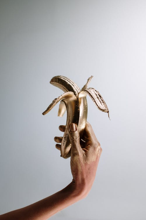 Photo Of Person Holding Gold Banana