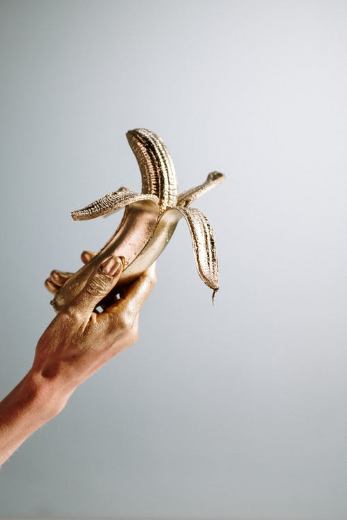 Photo Of Person Holding Golden Banana
