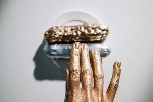 Close-Up Photo Of Golden Hands