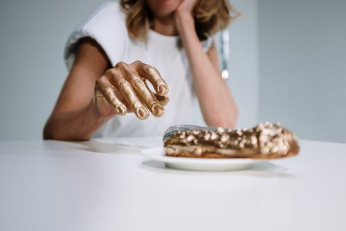 Photo Of Person With Gold Hands