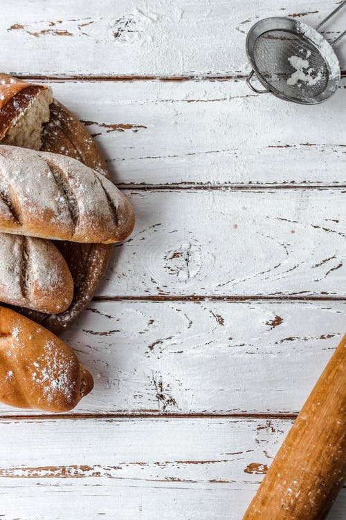 Photo Of Breads On Top Of Wooden Table
