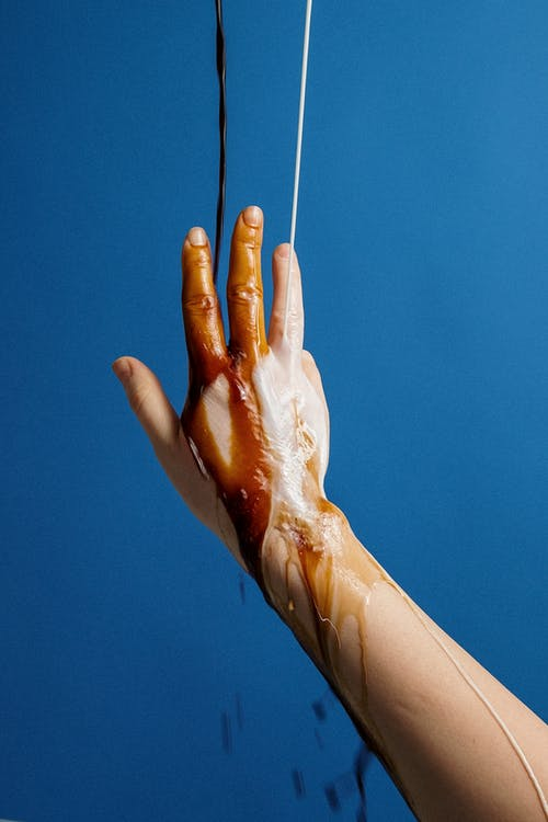Photo Of Liquid Poured Into Person's Hand