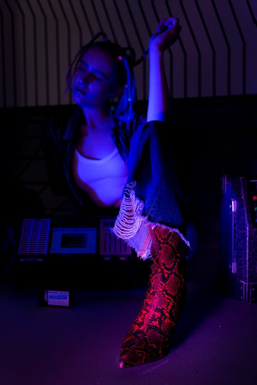 Photo Of Woman Wearing Snake Skin Boots
