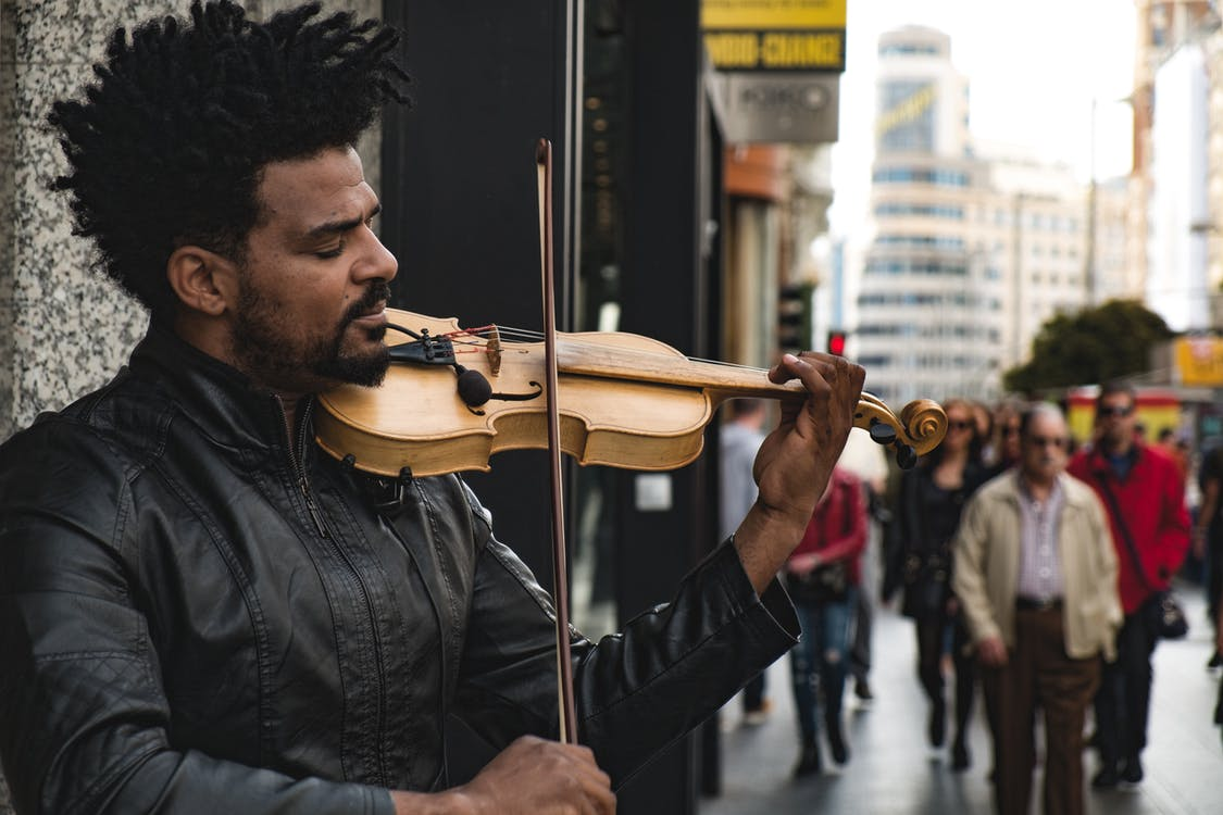 Man Playing Violin on The Street